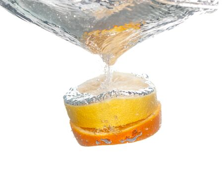 lemon with orange in water on a white background