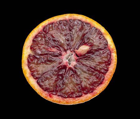 citrus fruit red orange on a black background Фото со стока
