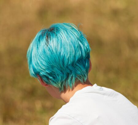 girl with blue hair on her head