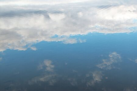 white clouds with reflection in the water