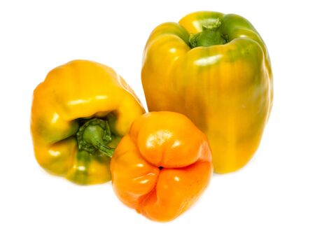 yellow and red bell peppers on a white background