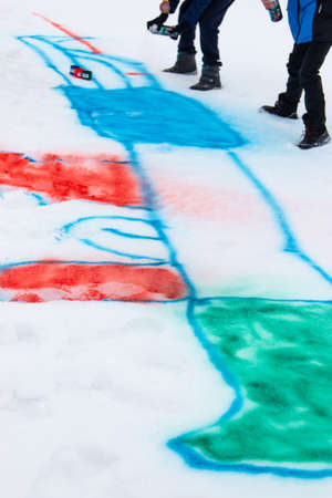 children paint in the snow