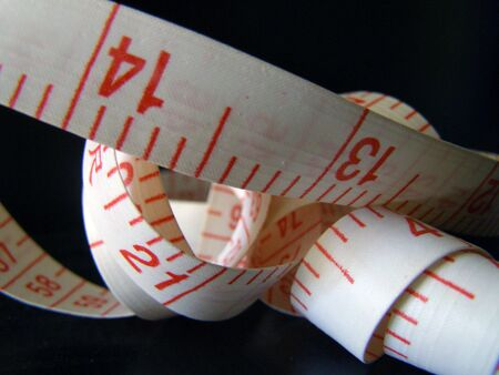 Closeup of tape measure from a sewing kit. Imagens