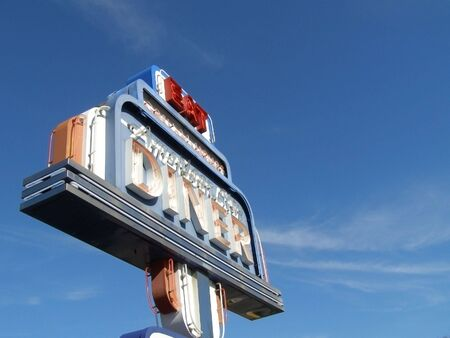 Sectional shot of neon diner sign detail. Banco de Imagens
