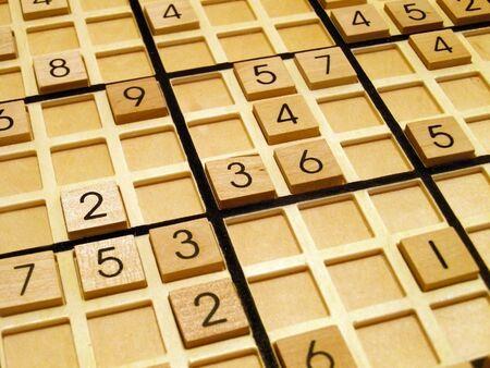 sudoku: Wood sudoku board and tiles. Stock Photo