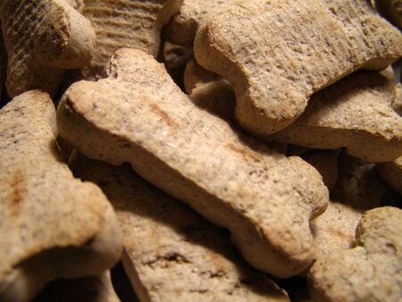 Detail close-up of dog cookies piled high. Banco de Imagens