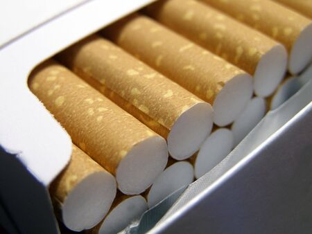 Detail close-up of cigarette filters in blank pack. Banco de Imagens