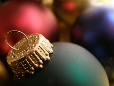 Extreme closeup of Christmas ornaments detailing the ornamental hooks. Stock Photo - 654599