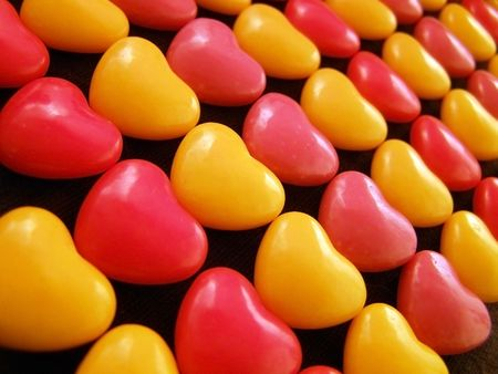 float cotton cloud: Candy hearts lined up by color. Stock Photo