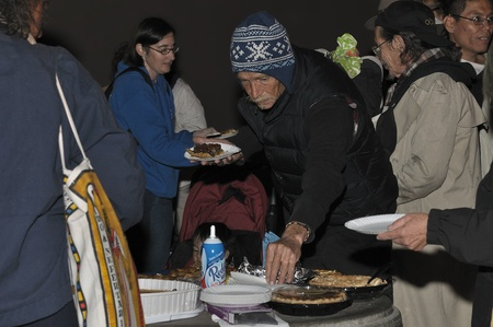 nonviolence: San Diego, California, USA, November 21, 2011: Occupy San Diego demonstrators and supporters gather at the Civic Center to enjoy Occu-PIE following a short service of peace, nonviolence, thanks and sharing led by multi-faith leaders of San Diego County