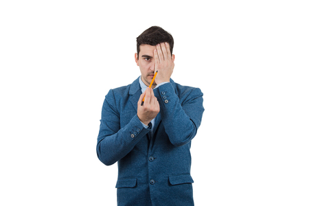Portrait of a businessman hiding half face with his hand trying to draw new identity against a white background.