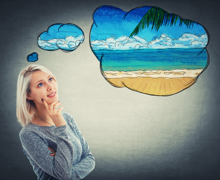 Portrait of thoughtful woman looking up and imagining a holiday at the sea beach. Dreaming of vacation with a positive face expression. Resting and relax planning on the exotic island shore. Stock Photo
