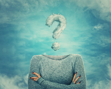 Surreal image as woman with crossed hands and invisible face has a question mark shaped cloud instead of head. Social mask for hiding his identity. Incognito introvert person with head in the clouds.