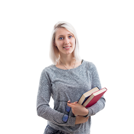 Smiling woman student, teacher or business lady holding books in one hand and eyeglasses in another isolated on white background. Banque d'images