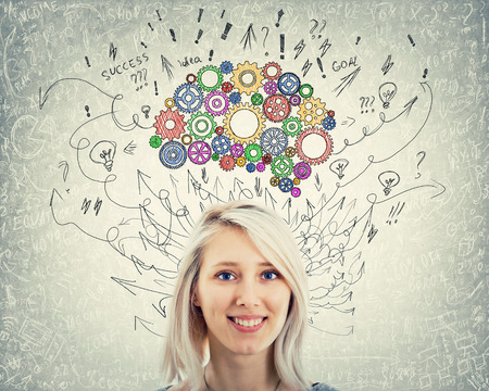 Close up portrait of a young woman with colorful gear brain above head. Happy emotion, positive thinking with arrows and curves as thoughts. Concept for mental, psychological development.