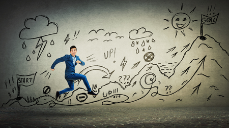 Businessman in suit running life quest with obstacles. Self overcome climbing mountain with ups and downs for reaching goals. Difficult road to finish flag. Career move metaphor.