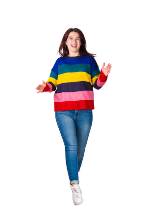 Cheerful girl jumping and dancing, happy human emotion full length portrait isolated over white background.