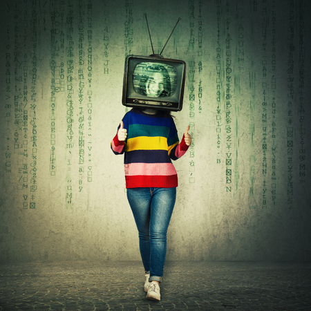 Casual young woman showing thumbs up like feedback gesture and old tv instead of head. Television manipulation and brainwashing concept. Mass media propaganda control. Matrix symbols falling down.