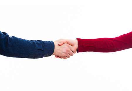 Close up of man and woman handshake isolated on white