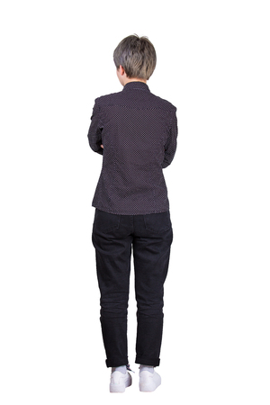 Full length rear view casual young woman hipster keeps arms folded isolated over white background. Confident female planning future business success. Imagens
