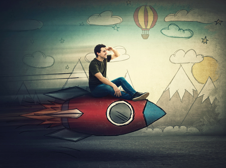 Amazed guy flying on a fast rocket looking hand to forehead looking far away for a vacation destination. Excited man searching for summer holiday. Positive dreamer emotions. Starting new adventure.