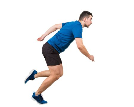 Side view full length of determined caucasian man athlete fast speed running isolated over white background. Young guy runner wearing black and blue sportswear makes a quick sprint.