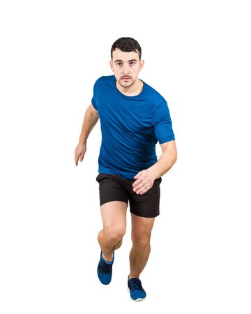 Full length of determined caucasian man athlete fast speed running to camera isolated over white background. Young guy runner wearing black and blue sportswear makes a quick sprint.