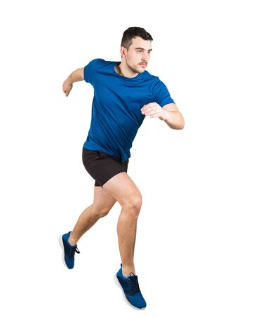 Full length of determined caucasian man athlete fast speed running isolated over white background. Young guy runner wearing black and blue sportswear makes a quick sprint.