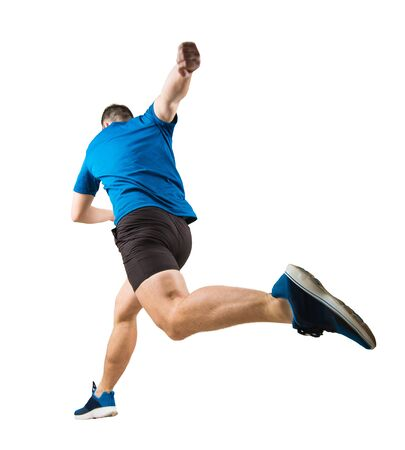 Full length rear view of determined caucasian man athlete fast speed running  or jumping over obstacle isolated over white background. Runner makes a sprint. Footballer kick the ball with his foot.