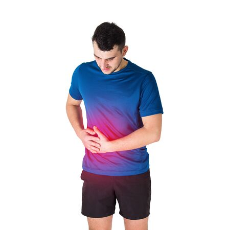 Caucasian man athlete feeling stomach pain and side stitch from exercise isolated over white background. Sportsman suffering muscle cramp. Sport traumas, physical injury and healthcare concept.