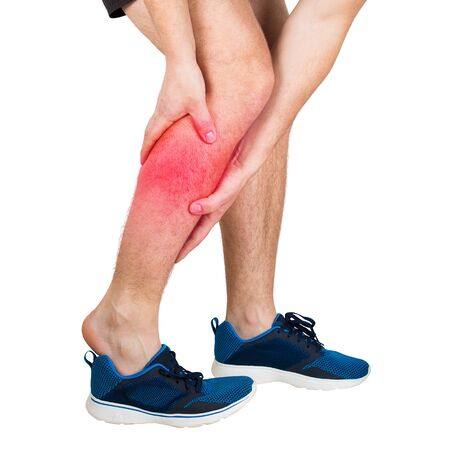 Close up of caucasian man athletic legs feeling calf pain from exercise isolated over white background. Sportsman suffering muscle cramp. Sport traumas, physical injury and healthcare concept. Banco de Imagens - 124902572