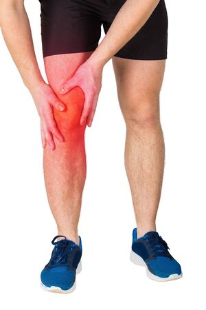 Close up of caucasian man athletic legs feeling knee pain from exercise isolated over white background. Sportsman suffering muscle cramp. Sport traumas, physical injury and healthcare concept.