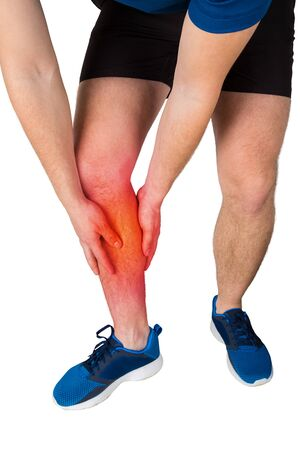 Close up of caucasian man athletic legs feeling calf pain from exercise isolated over white background. Sportsman suffering muscle cramp. Sport traumas, physical injury and healthcare concept. Banco de Imagens - 124902627