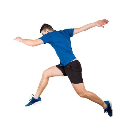 Side vie full length of determined man athlete jumping over imaginary obstacle isolated over white background. Young guy runner in sportswear makes sprint for leap over chasm. Imagens