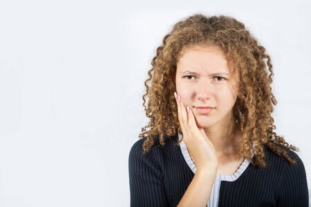 Young girl suffering from toothache, tooth decay or sensitivity. Dental Health And Care Concept. Stockfoto