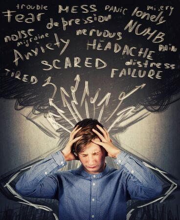 Scared teenager boy mess in head, hands covering ears, eyes closed feeling pain, headache and emotional stress. Anxiety, mental health problems, adolescent depression. Dementia disease, schizophrenia.