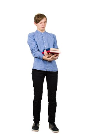 Full length portrait of scared student boy carrying two heavy books in his hands isolated over white background. Has to study the much hated school disciplines, guy tired of constant learning.
