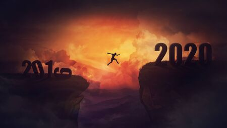 Surreal scene, man jump over a chasm obstacle between 2019 and 2020 years. Self overcome, starting a new year. Way to win and success, sunset sky background. Motivational achieving goals concept. Reklamní fotografie