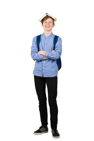 Full length happy student boy looks to camera positive expression, keeps open book over head and arms folded, demands holidays, isolated over white background. Back to school concept. Stok Fotoğraf