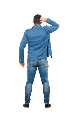Rear view full length of young businessman, hand to head thoughtful gesture, isolated on white background. Business planning concept, puzzled man search for answer.