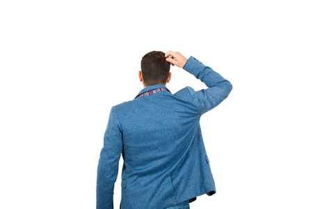 Rear view of confused young businessman, hand to head thoughtful gesture, isolated on white background. Business planning concept, puzzled man search for answer.