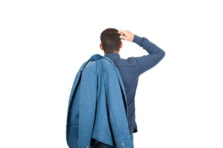 Rear view of pensive young businessman, hand to head thoughtful gesture, keeps his jacket on shoulder, isolated on white background. Business planning concept, puzzled man search for answer.