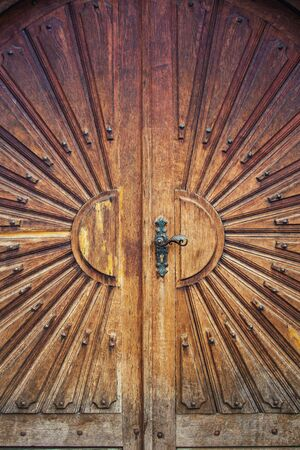 Old wooden door background showcase traditional antique ornaments. Beautiful wood carving doorway entrance.