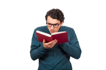 Portrait of stupefied nerd student guy, or professor wears eyeglasses, looking bewildered, double checking information from the book. Shocked reader, poor sight farsightedness isolated on white. Banco de Imagens
