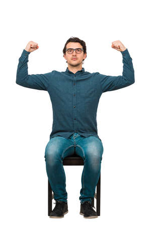 Full length confident businessman seated on chair, flexes muscles imagine superpower, isolated on white. Business person, looking determined. Personal development, power and motivation concept. Banco de Imagens