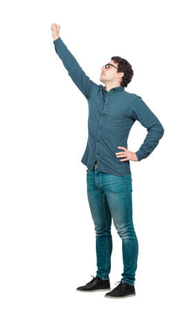 Cheerful businessman, full length portrait, raising one arm as a leader, looking up confident. Brave guy, winning gesture isolated on white background. Ambition and business success concept.