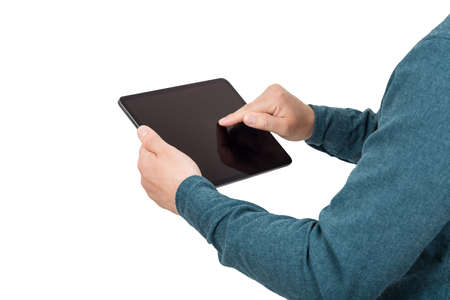 Close up person hands using a PC tablet as pressing the blank gadget display isolated on white background with copy space. Modern technology and education concept. Businessman working from home.