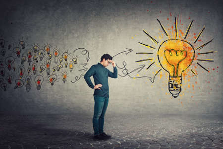 Side view full length, pensive man keeps hand to forehead, hard thinking for the best solution. Ingenious business person or student gathering new ideas into a big lightbulb. Genius creativity concept