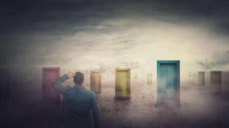 Rear view businessman in front of many different doors choosing one. Difficult decision, important choice, failure or success concept. Decisive ways to unknown future, business opportunity symbol.