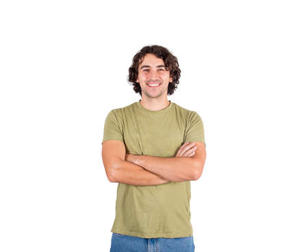 Portrait of smiling brunette young man, long curly hair style, keeps arms folded looking confident to camera isolated on white background. Cheerful and successful caucasian guy, casual lifestyle.